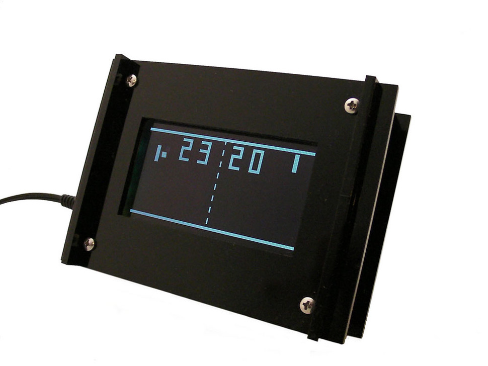 Assembled clock with LCD and game of PONG playing with time displayed as the score