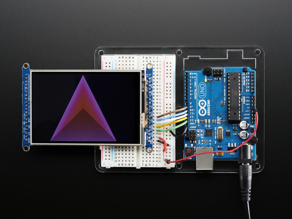 TFT breakout wired to arduino, displaying colorful triangles