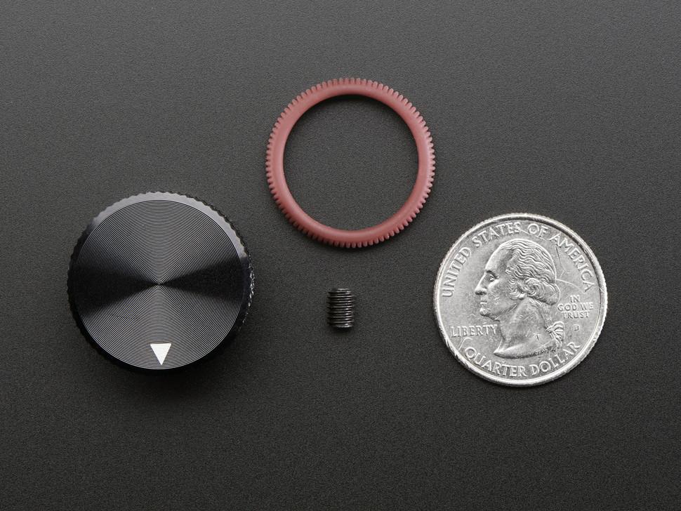 Top down of knob, rubber grib, set screw, next to quarter