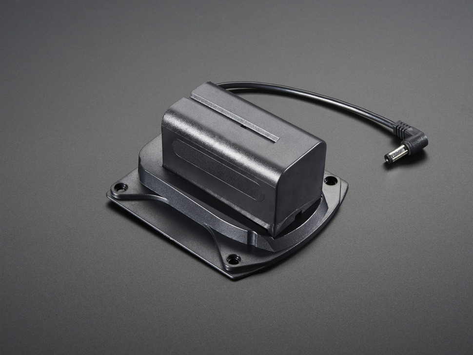 Reverse angled shot of camcorder battery holder/adapter with DC jack.