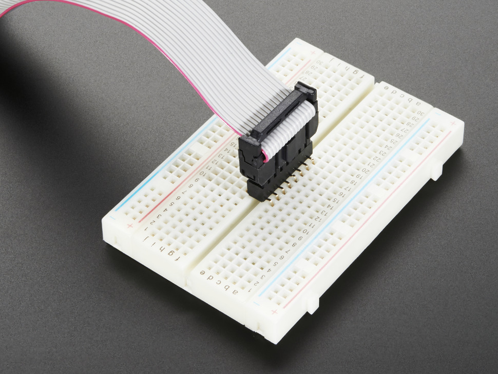 Helper installed in solderless breadboard, with cable attached