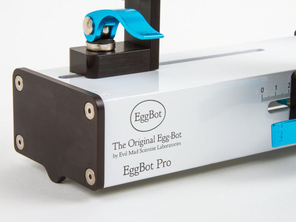 Close up of Egg bot logo on metal