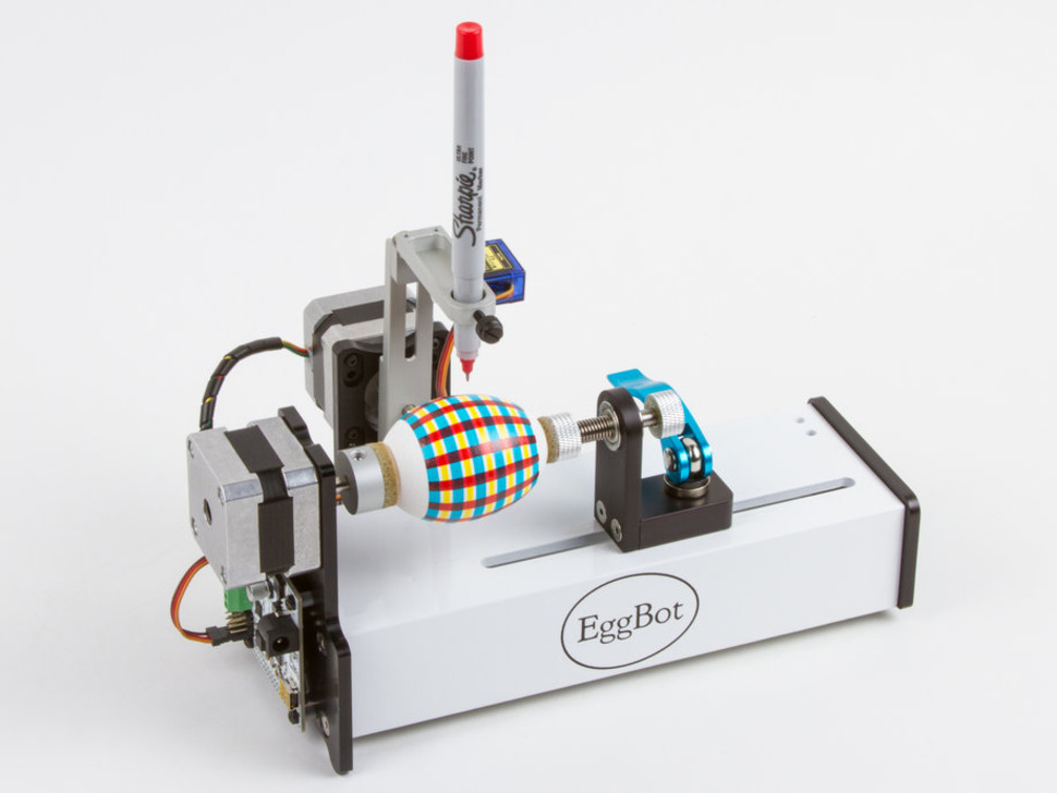 eggbot drawing a plaid design onto an egg with a sharpie pen.