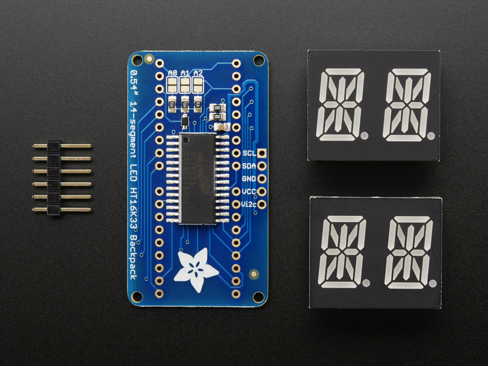 Kit shot with breakout board, two dual LED modules, and header
