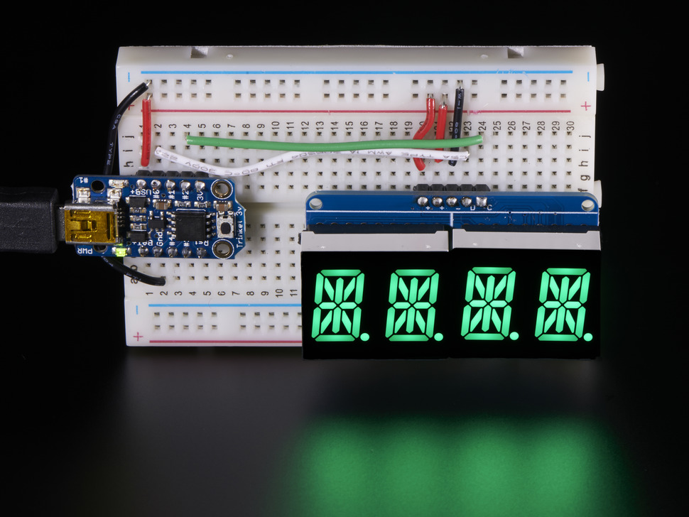 Display wired to an Arduino on breadboard showing all segments lit