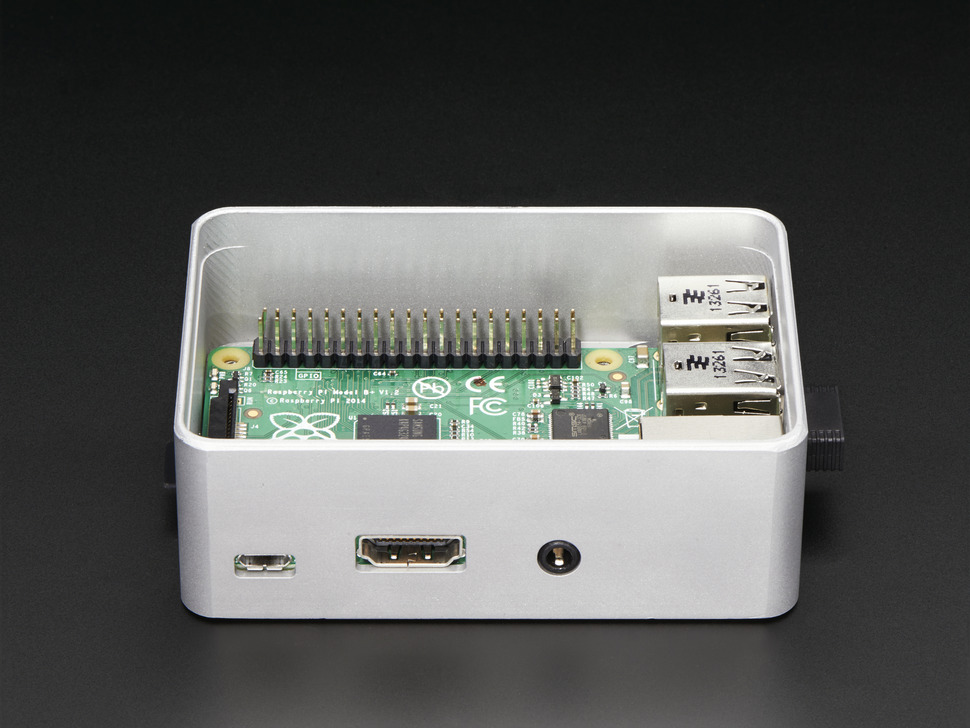 Side shot featuring microUSB port, HDMI port, and headphone jack on assembled aluminum case for Raspberry Pi - Model B+ / Pi 2 / Pi 3.