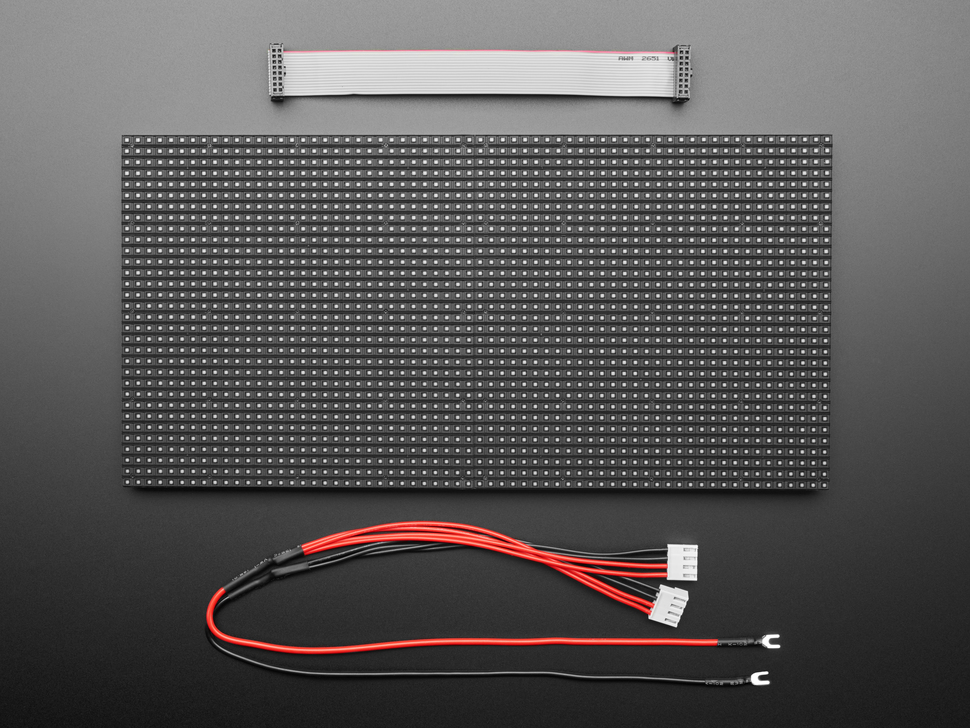 Dissassembled and powered off 64x32 RGB LED Matrix Panel - 5mm pitch with power cable and IDC cable.