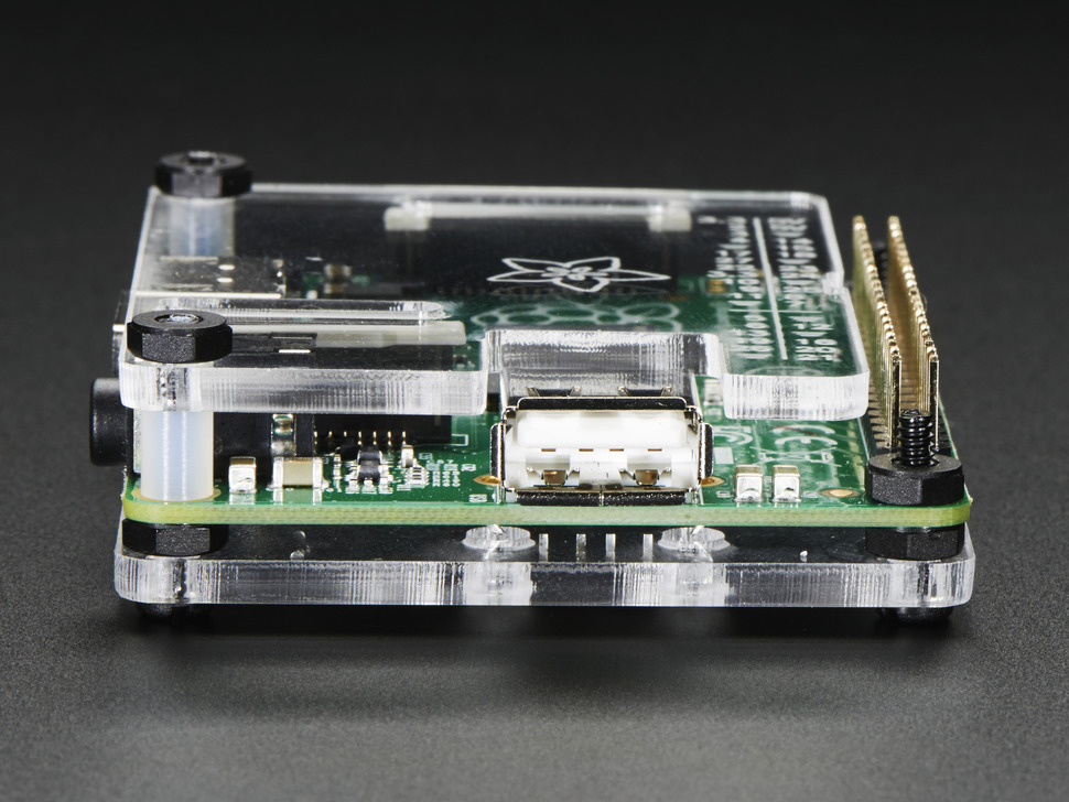 Side shot of assembled clear acrylic Enclosure for Raspberry Pi Model A+ featuring the USB port.