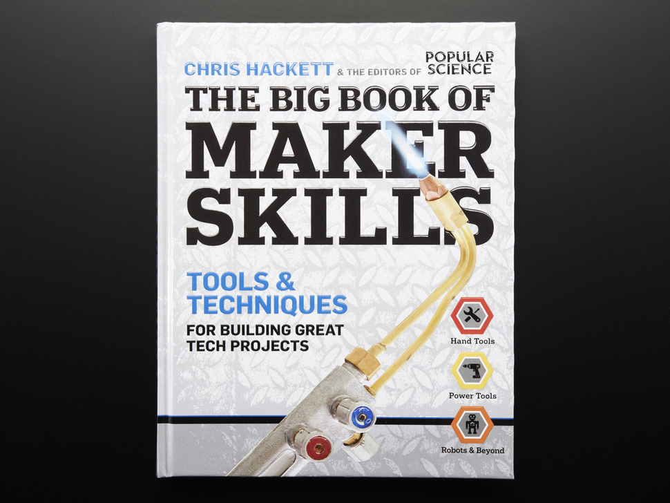 Front cover of The Big Book of Maker Skills by Chris Hackett & the editors of Popular Science. Tools & techniques for building great tech projects. Closeup of a blow torch powered on with a blue flame.