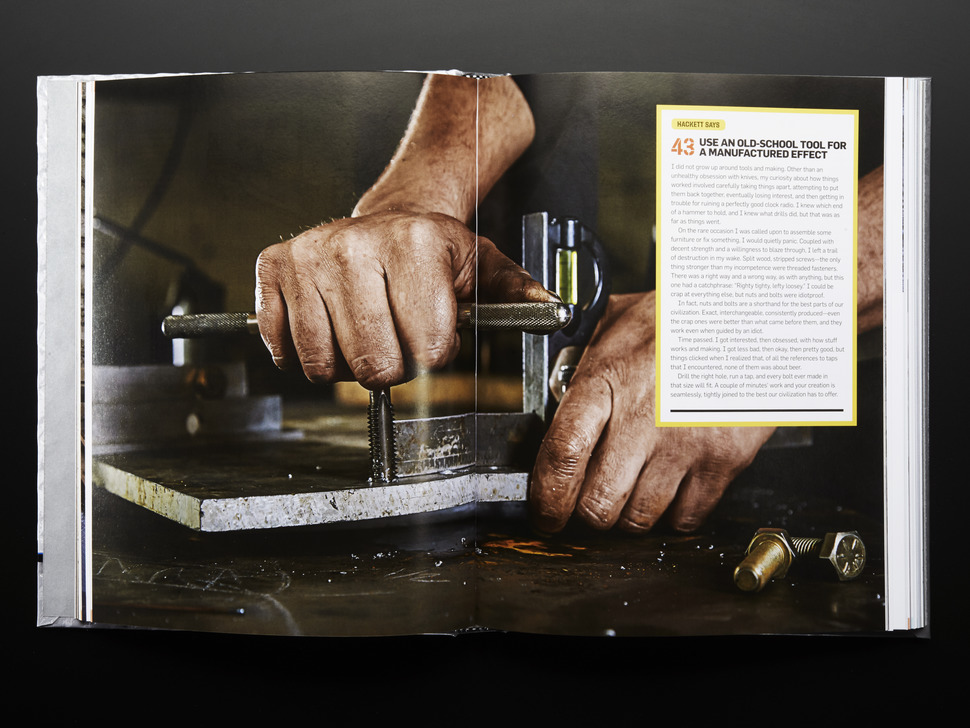 open book spread to using an old school tool for a manufactured effect. Closeup of a white man operating a CNC machine.