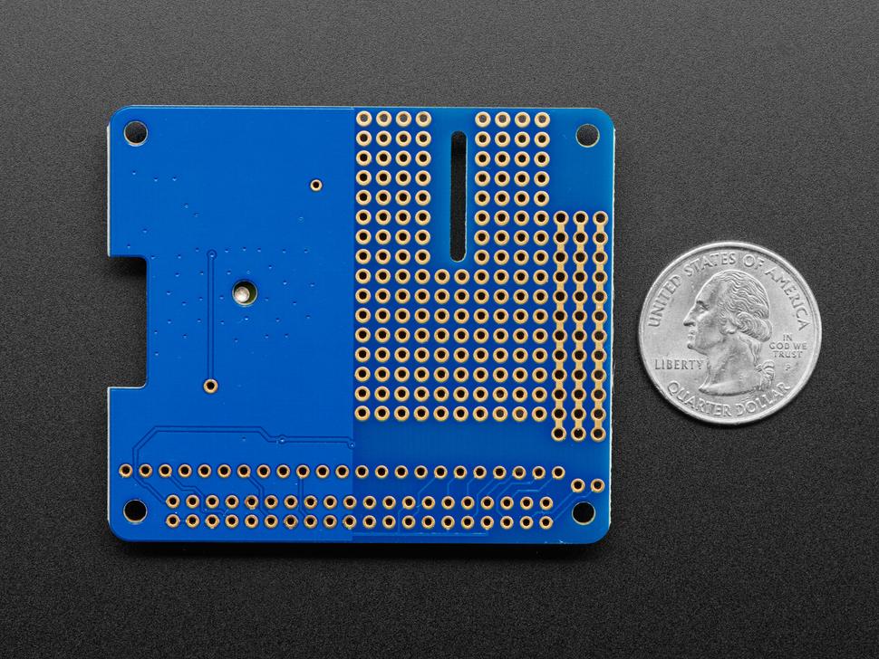 Back shot of Adafruit Ultimate GPS HAT for Raspberry Pi A+/B+/Pi 2/3/Pi 4 measured by a US quarter