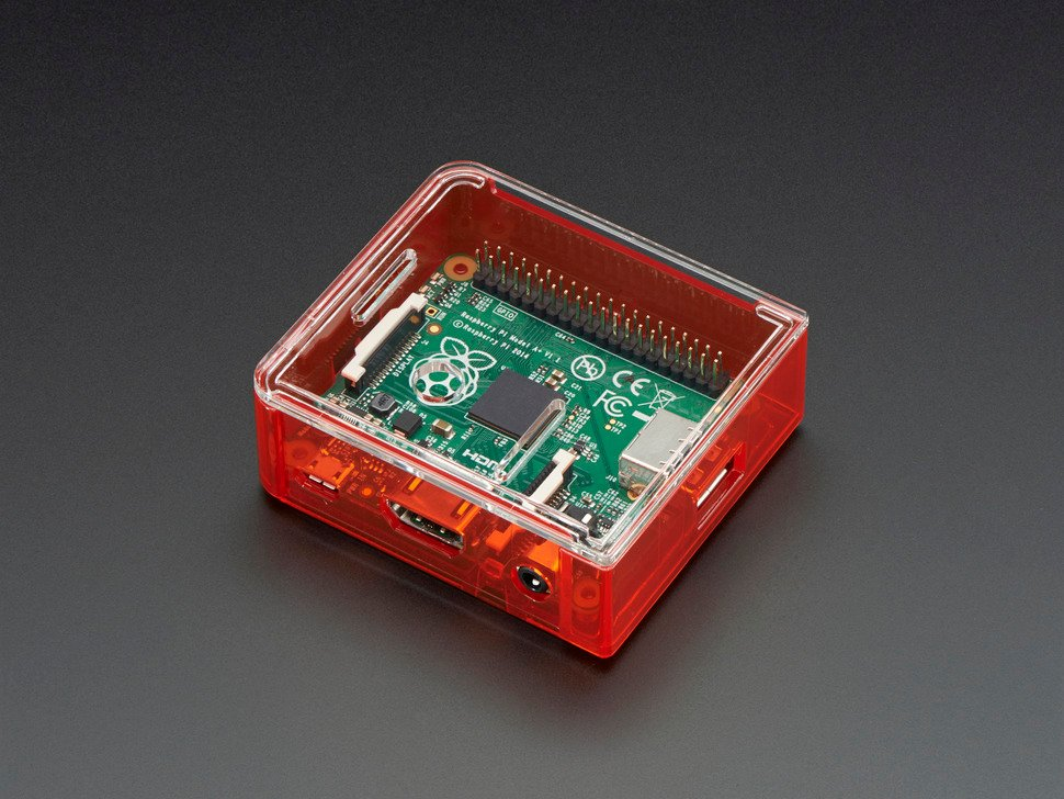 Angled shot of red Raspberry Pi Model A+ Case with clear lid.