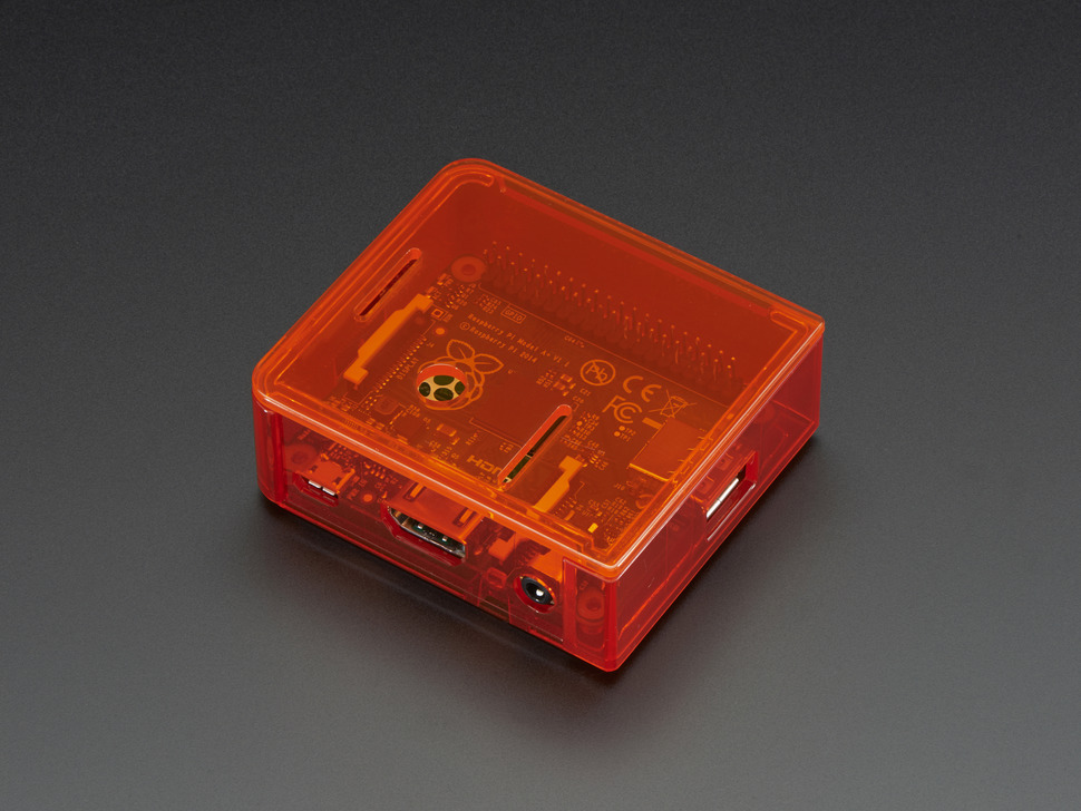 Angled shot of red Raspberry Pi Model A+ Case with red lid.