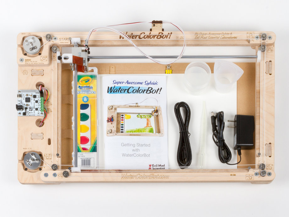 Kit content shot with watercolor drawing robot, power supply, water colors, etc.