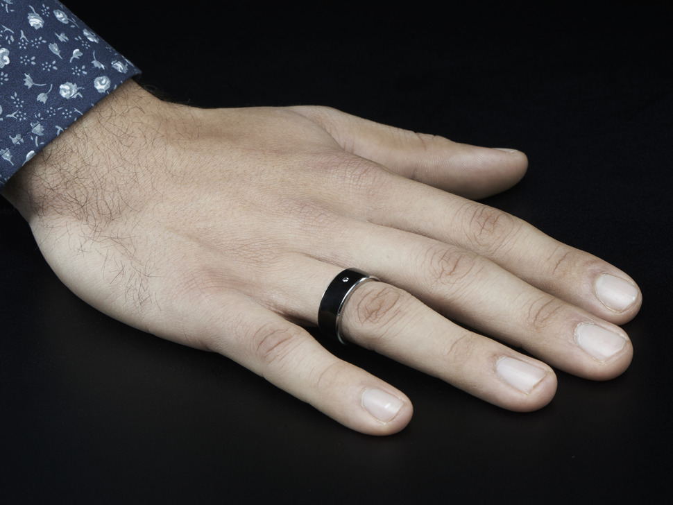 Male hand with ring on ring finger