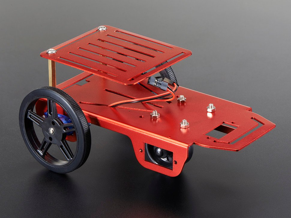 Assembled red metal robot with two wheels and caster.