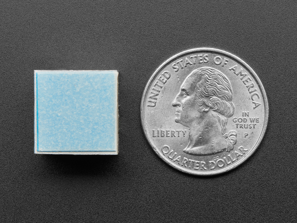 heat sink next to quarter for scale