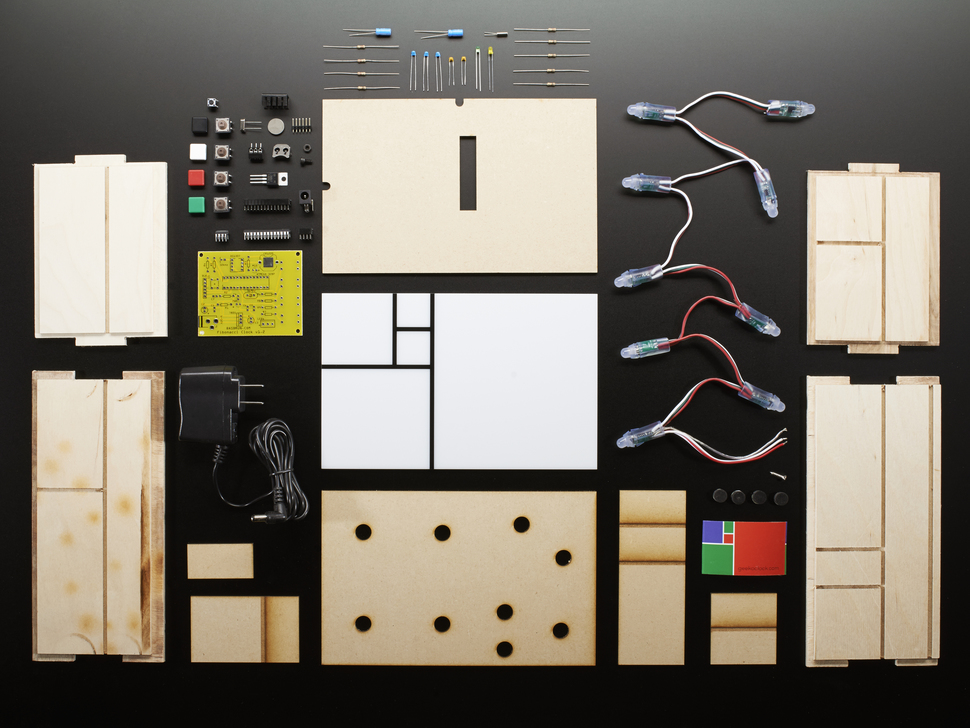 Unassembled kit shot with PCB, enclosure and loose parts.