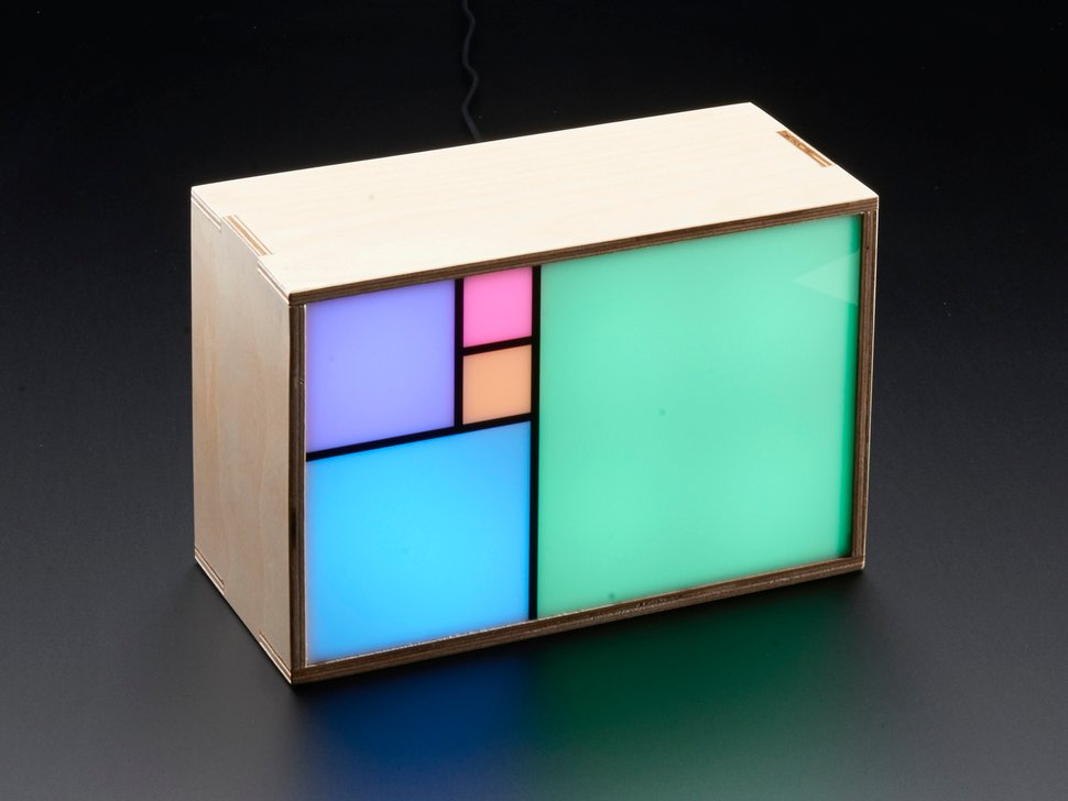 Still shot of clock with 5 squares showing different colors
