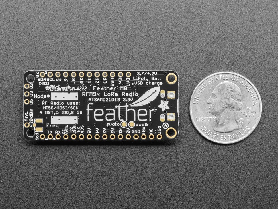 Back shot Adafruit Feather M0 with RFM95 LoRa Radio - 900MHz measured by a US quarter
