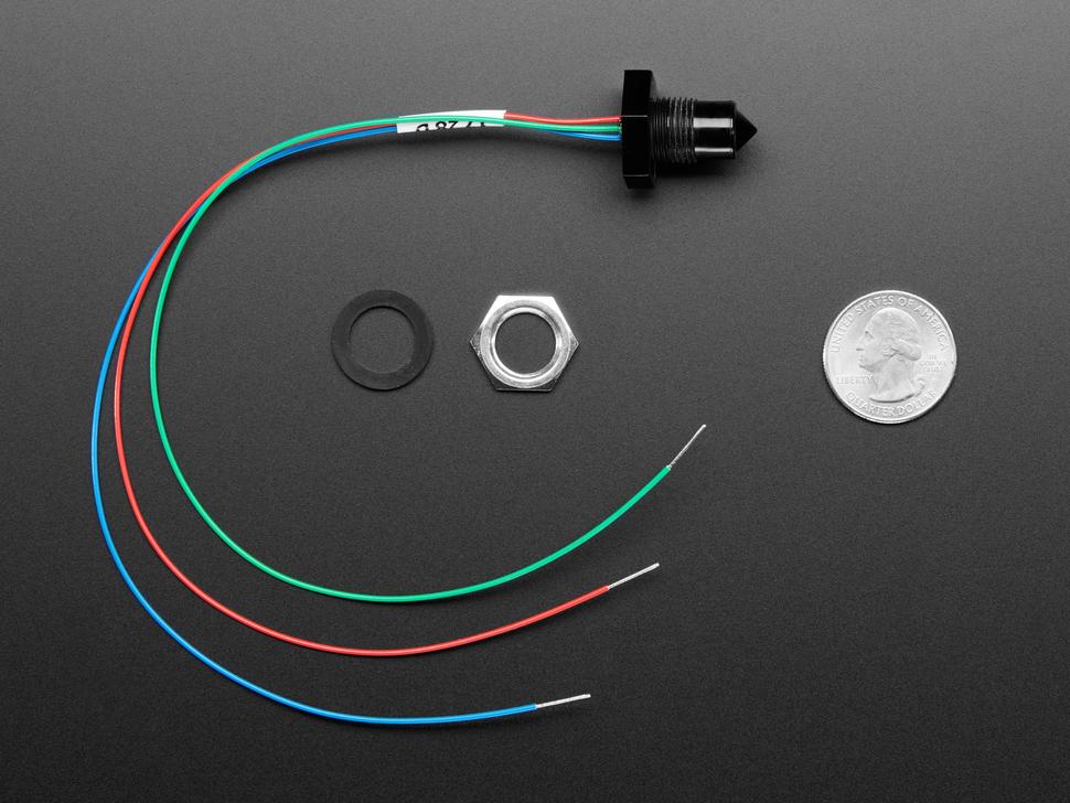 Profile shot of hardware, sensor, wires all next to quarter