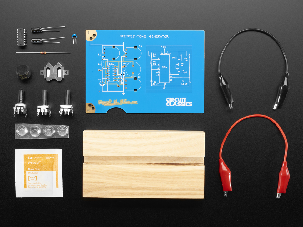Kit contents with PCBs, parts, and mounting hardware