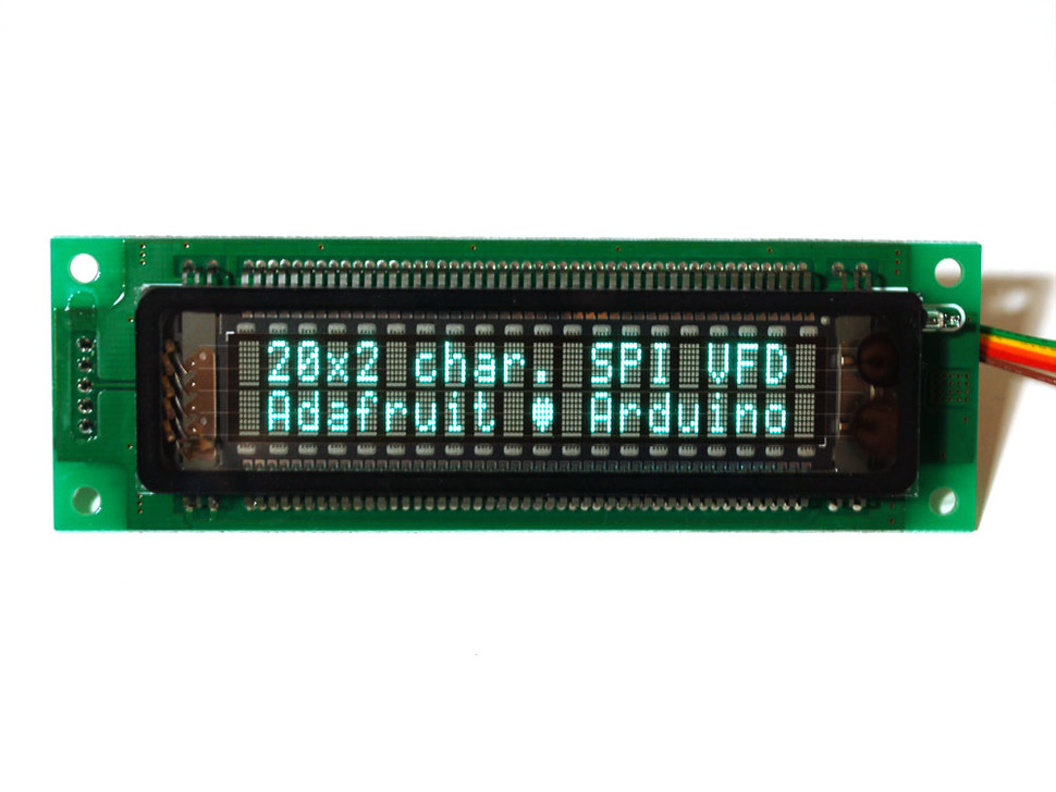 "20x2 Character Vacuum Fluorescent Display lit up with text ""20x2 char. SPI VFD. Adafruit heart Arduino"""