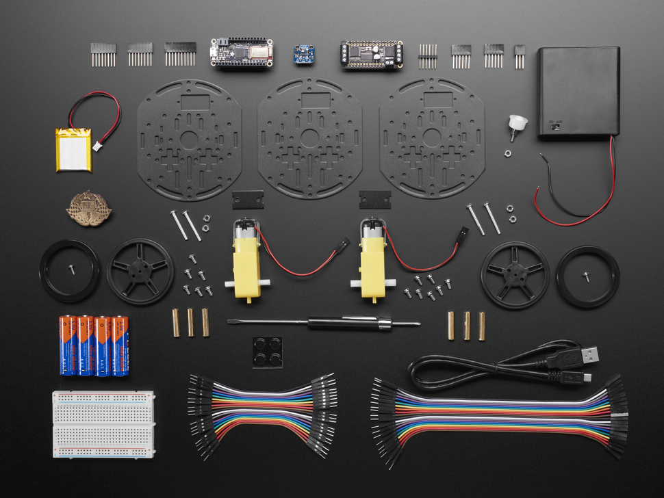 My Mini Race Car Project Pack Showing all the components include, hardware, PCBs and motors.