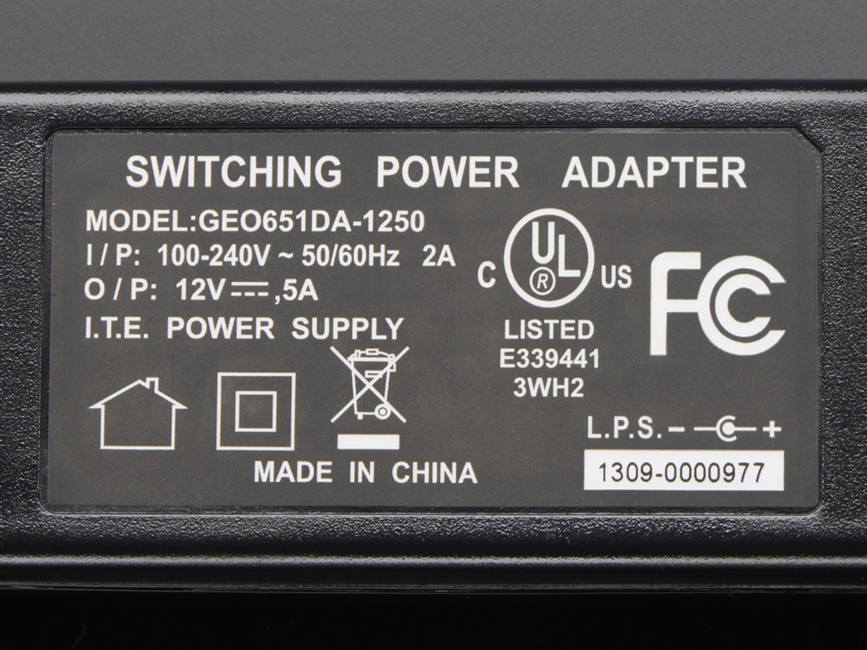 Power supply label with UL and FCC markings