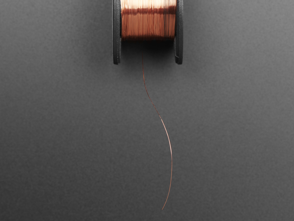 Close up of thin wire un-spooled