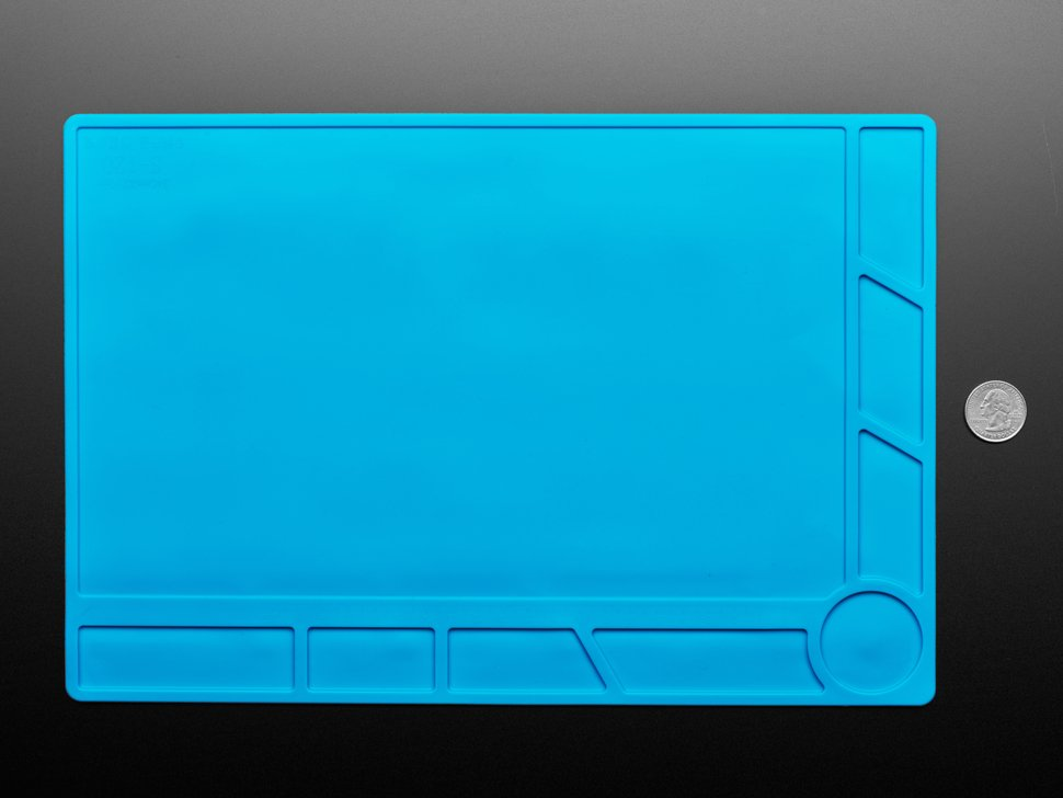 Large blue silicone mat next to quarter