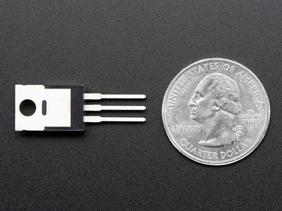 MOSFET next to quarter for scale