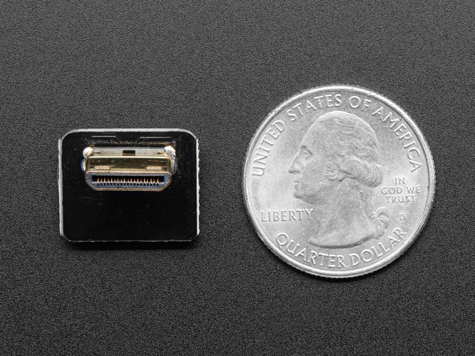 Right Angle (L bend) Mini HDMI Plug next to quarter for size comparison