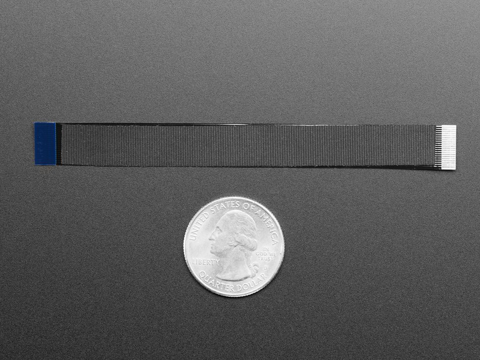 Ribbon Cable next to quarter for size comparison
