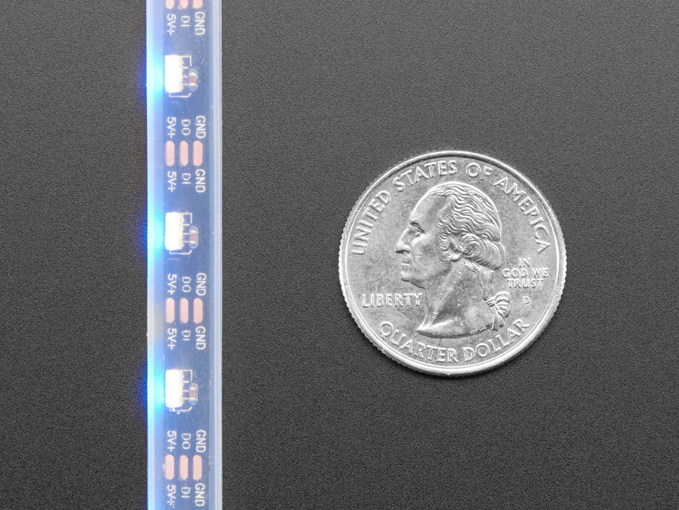 Detail of top of LED strip next to quarter