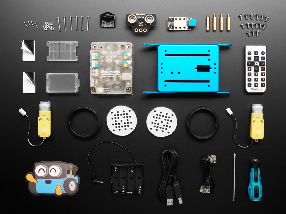 Kit component shot with rectangular metal piece, wheels, motors and other hardware.