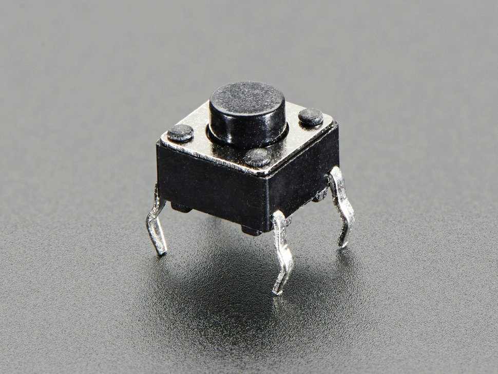 Closeup of mini tactile button switch.