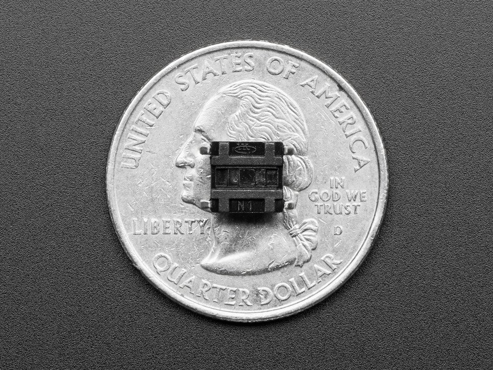 Mini tactile button switch on top of US quarter