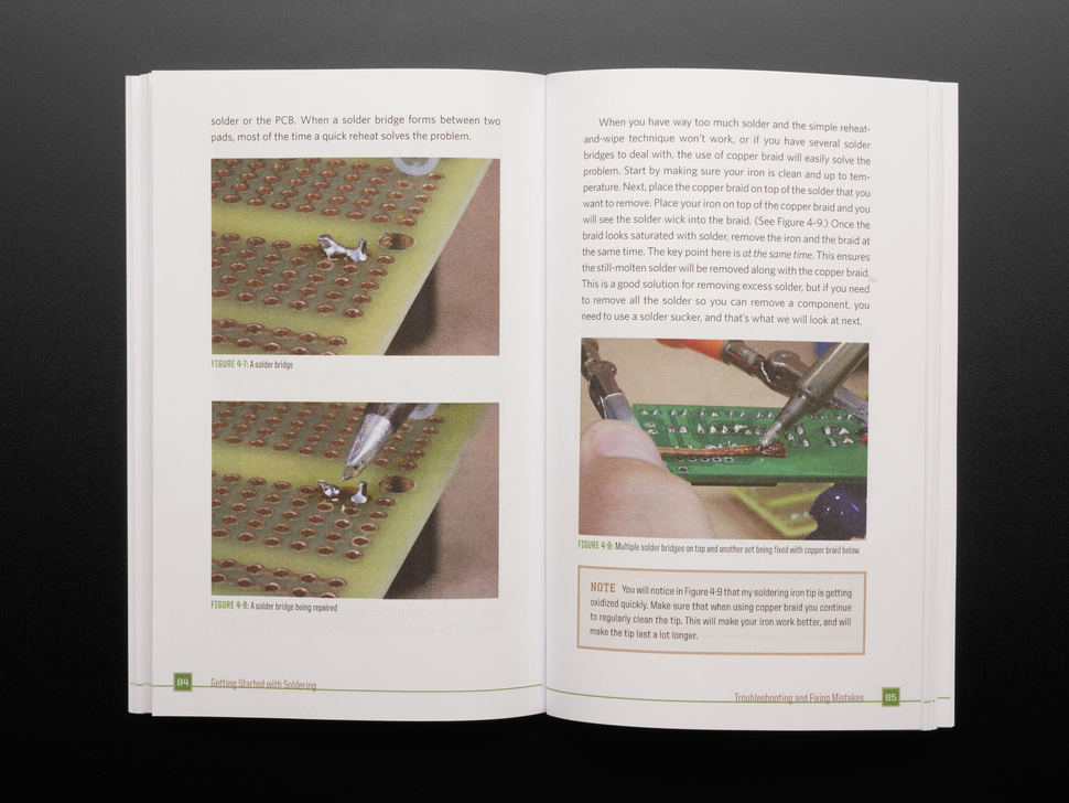 Open book spread featuring photographs of circuit boards and soldered connections.