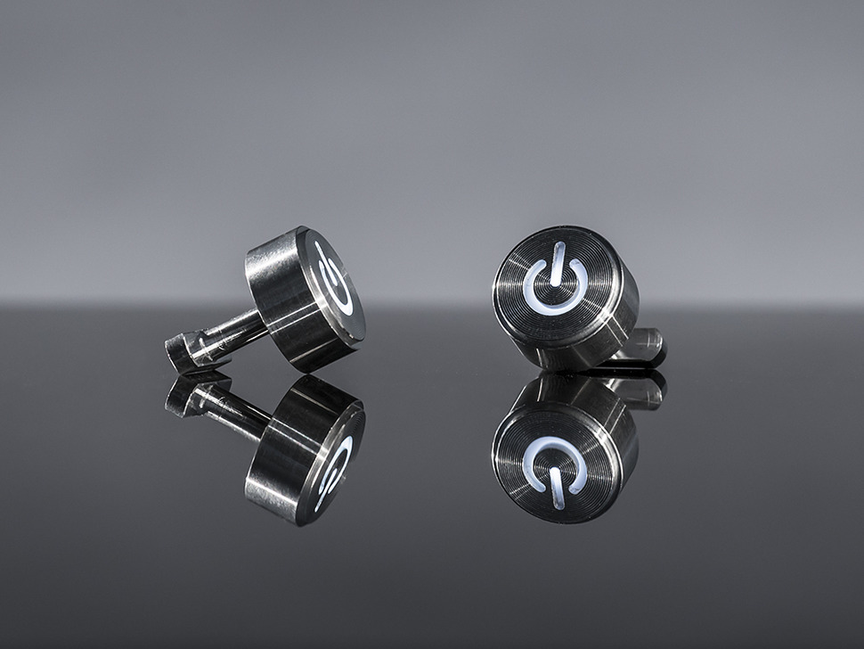 Metal cufflinks with light up image of a power button on them