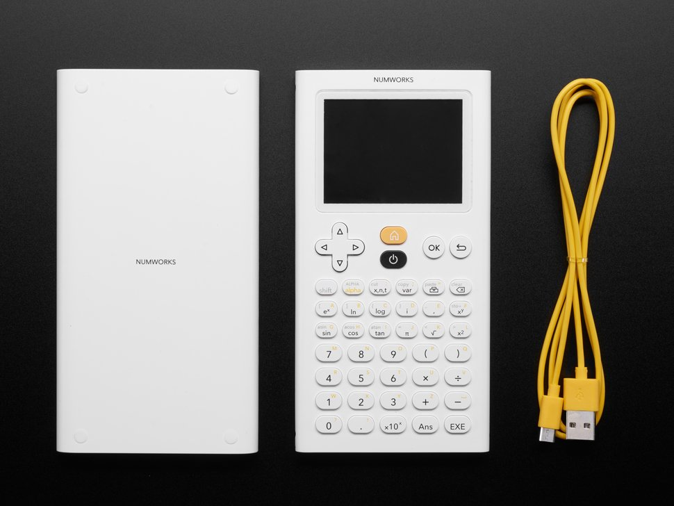 Top down shot of calculator, cover and USB cable