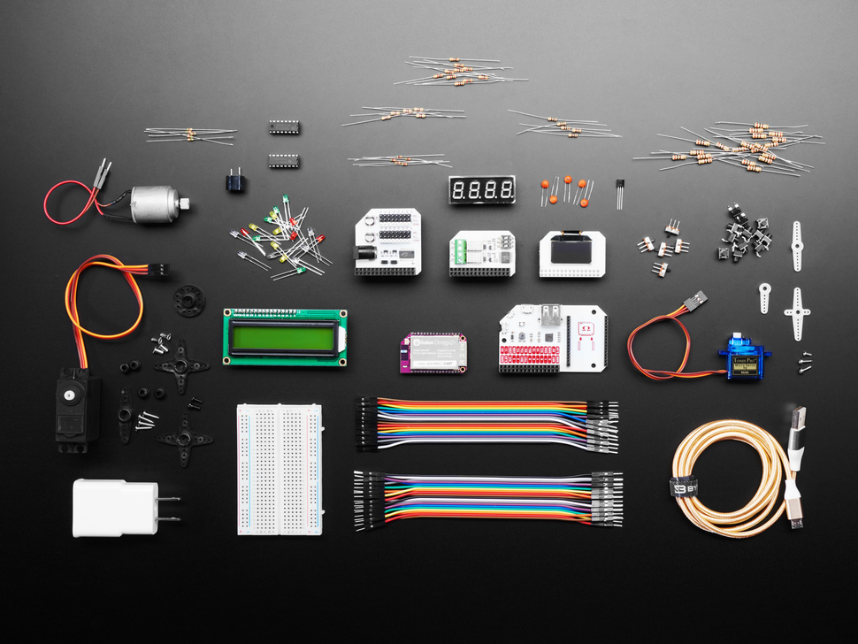 Kit contents shot with Omega board, various components, modules, wires, LCD and breadboard