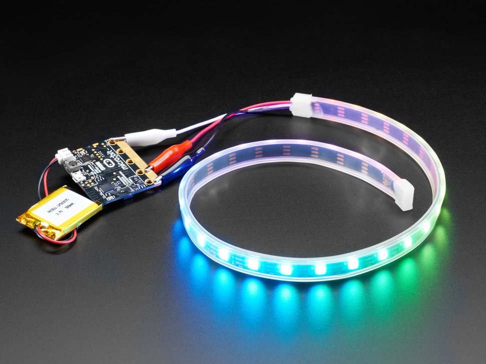 Angle shot of LED strip wired to Micro Bit, lighting up rainbow