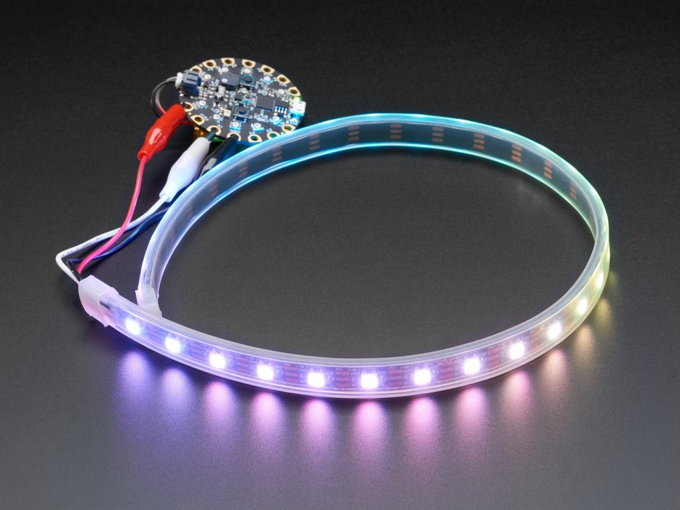 Angle shot of LED strip wired to Circuit Playground, lighting up rainbow
