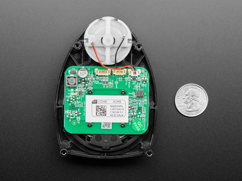 Side by side shot of the lamtec RPLIDAR A1 - 360 Laser Range Scanner measured by a quarter