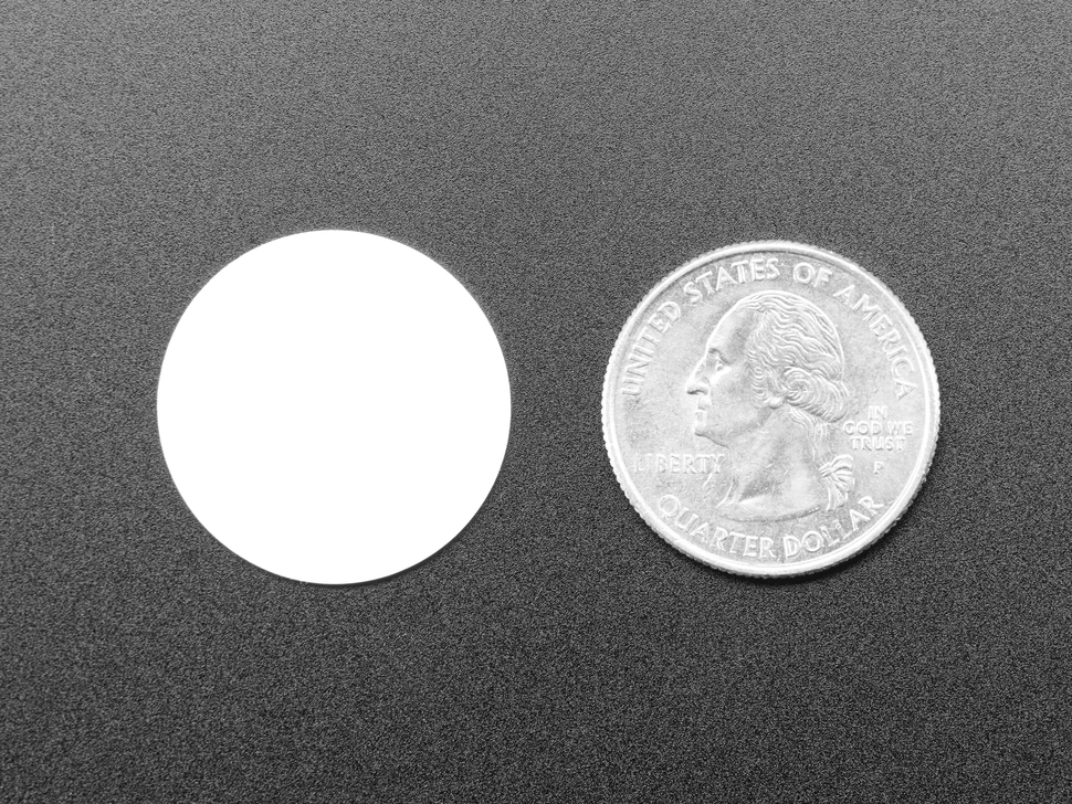 White disc next to quarter