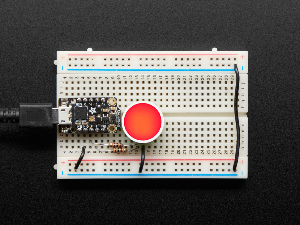 Indicator LED wired to Arduino on breadboard and lit red