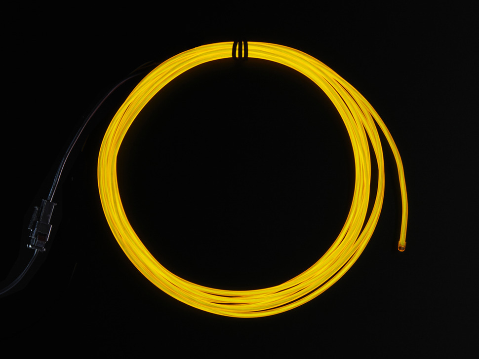 Coil of lit EL wire in yellow