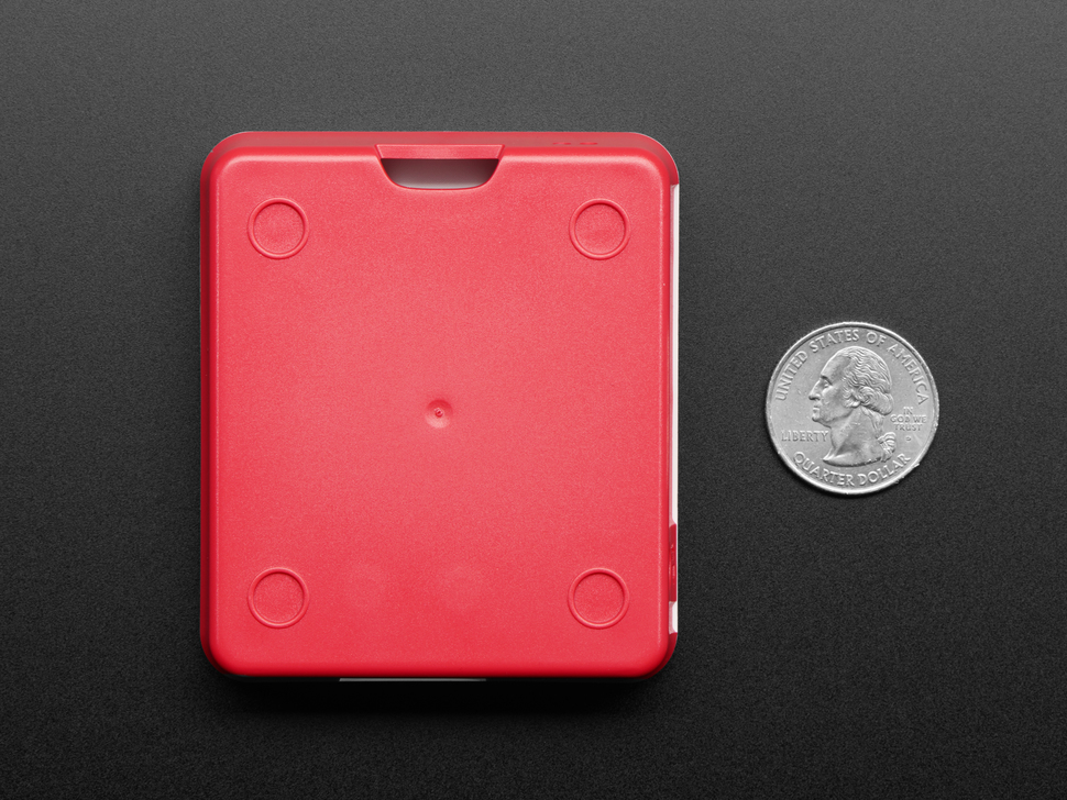 Bottom of assembled Raspberry Pi Model 3 A+ case next to US quarter.