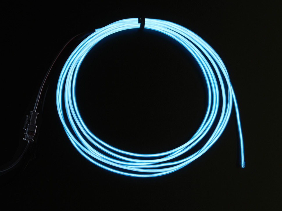 Coil of lit EL wire in white